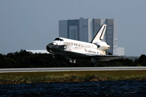 Space shuttle orbiter vehicle Discovery landing at the end of Mission STS-120 in November 2007.