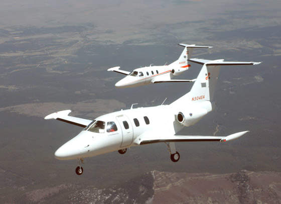 Flight test aircraft N504EA and N503EA, flying in April 2005.