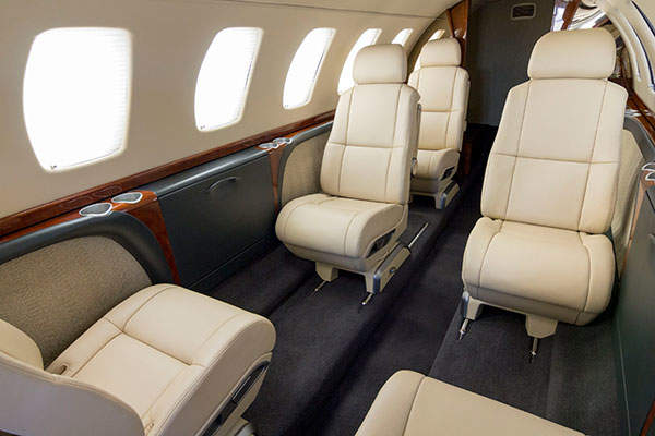 The cabin of the CJ3+ business jet includes six standard seats and can accommodate up to nine passengers.