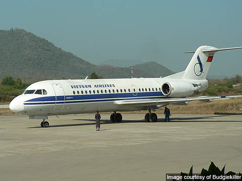 A Fokker F70 procured by Vietnam Airlines parked at the Luang Prabang International Airport, Laos.
