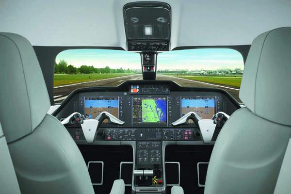 Flight deck of the Phenom 100 with Garmin Prodigy avionics suite.