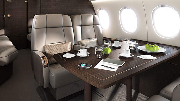 The dining lounge of the Falcon 900LX.
