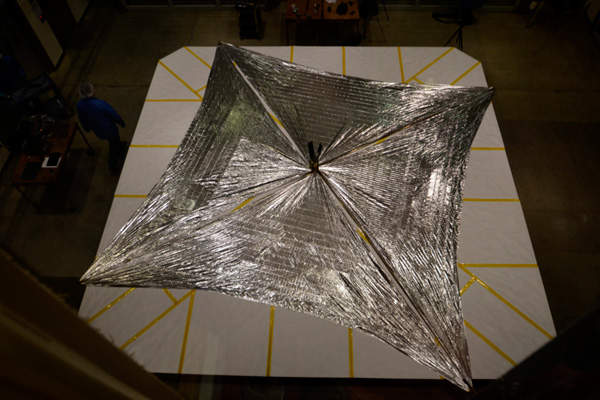 The solar sails of LightSail-1 are made of Mylar, a reflective polyester film. Image courtesy of The Planetary Society.
