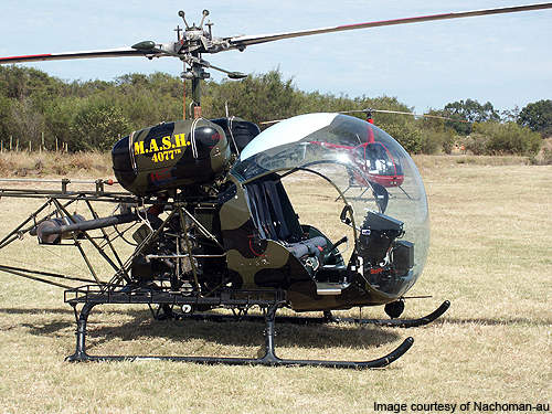 The Bell 47G in MASH paint.