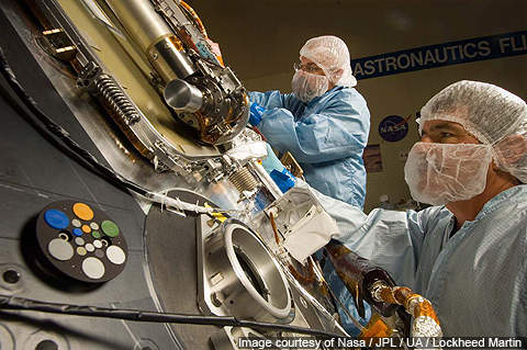 Technicians working on the science deck of the Phoenix lander.