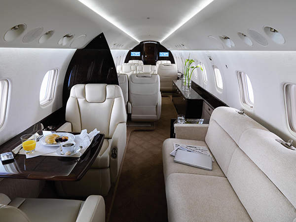 The cabin of the aircraft has three zones with comfortable seating. Image courtesy of Embraer.