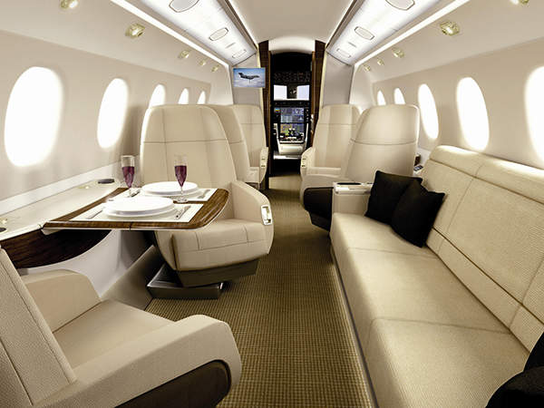 The cabin of the Legacy 500 features LED lighting, 26.5-inch-wide seats and a side-facing divan. Image courtesy of Embraer Executive Jets.