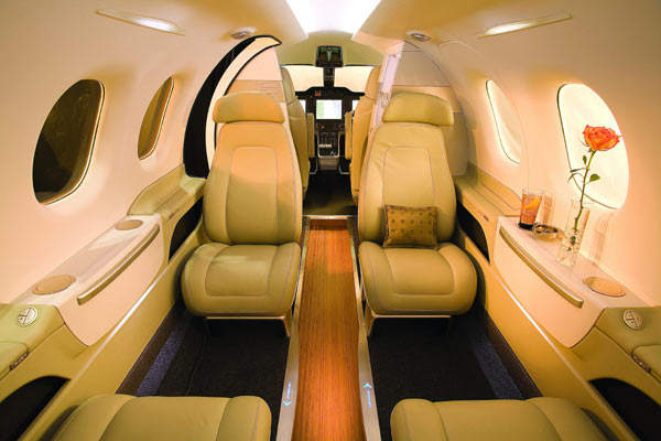 The Phenom 100 cabin lay-out typically seats four passengers.