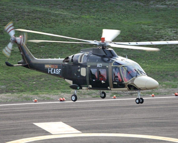 A prototype of the AgustaWestland AW169 lifts-off from a helipad during its maiden flight.
