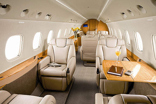 The aircraft cabin features fully berthing seats. Image courtesy of Embraer Executive Jets.