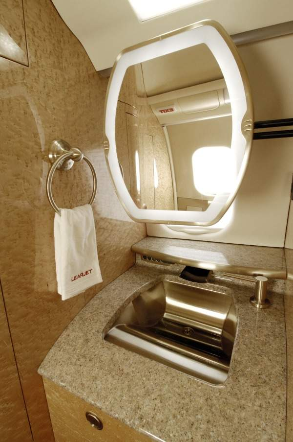 The Learjet 60XR features a belted lavatory and a reclaimed window at the aft lavatory. Image courtesy of Bombardier Business Aircraft public relations.