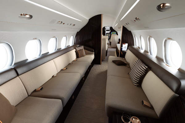 The jet has a spacious and long three-lounge cabin. Image courtesy of Dassault Aviation.