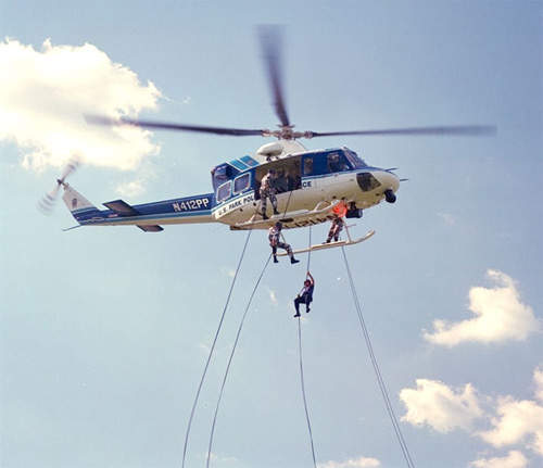 US Parks Police Service Bell 412 with personnel using rappel equipment.