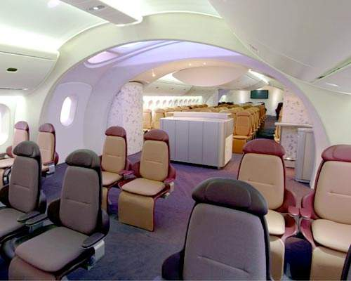 Boeing has explored radical new concepts for the interior cabin configuration including 'sweeping arches' and 'a calming, simulated sky' to enhance passenger perception of spaciousness.