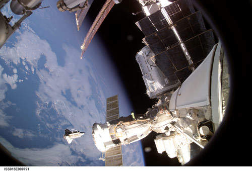 Space shuttle Discovery after undocking from the International Space Station in November 2007. A Soyuz spacecraft docked to the station can be seen in the foreground.