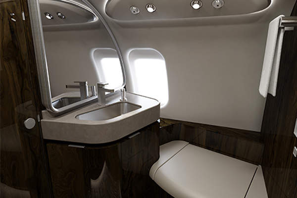 The cabin's floor plan incorporates an extended washroom compartment which can be doubled as a full-size changing room. Image courtesy of Bombardier.