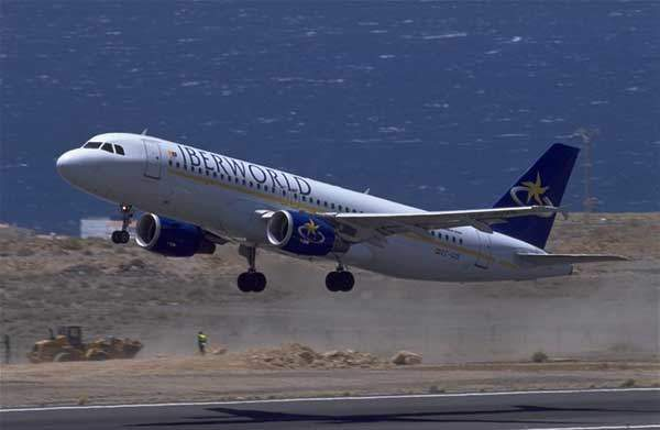A320 in service with Iberworld of Spain, taking off.
