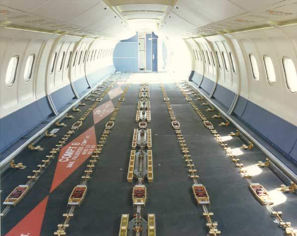 The interior of the roller floor of the BAE 146QC. The BAE 146QC (quick change) features a palletised seating system that can be offloaded and replaced with palletised containers in about 30 minutes.