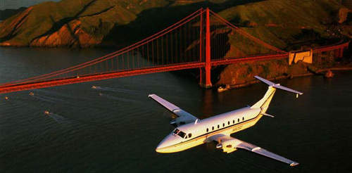 The Beech King 1900 flying over the Golden Gate Bridge.