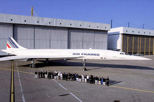 The Air France Concorde team with pilots, flight engineers and maintenance staff in front of the Air France maintenance hangar at Charles de Gaulle Airport.