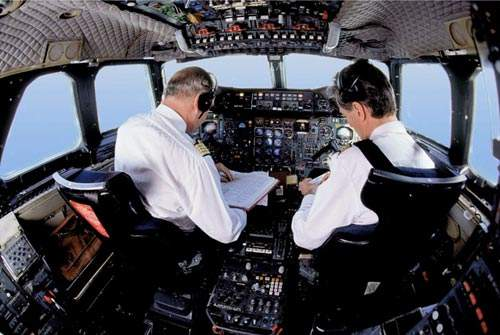 The Air France Concorde flight deck showing chief pilot and first officer preparing for take-off.