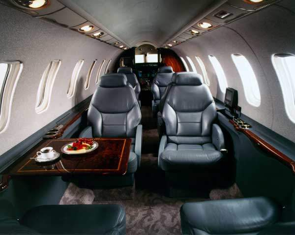 The passenger cabin seats up to nine passengers in double-club seating.