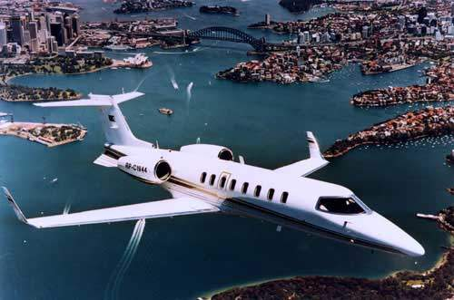 The Learjet 45 business jet aircraft, shown here flying over Sydney Harbour in Australia, has been designed to provide midsize comfort at a light-jet price.