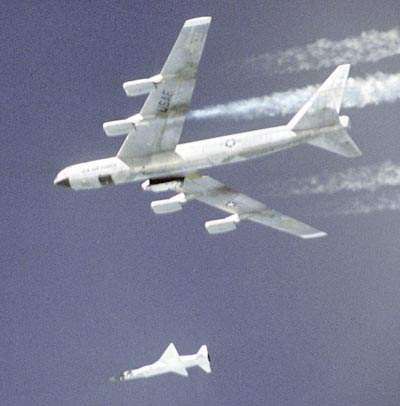 In March 2004, a modified Pegasus booster rocket and X43 vehicle drop steadily away from the NASA B-52B aircraft.