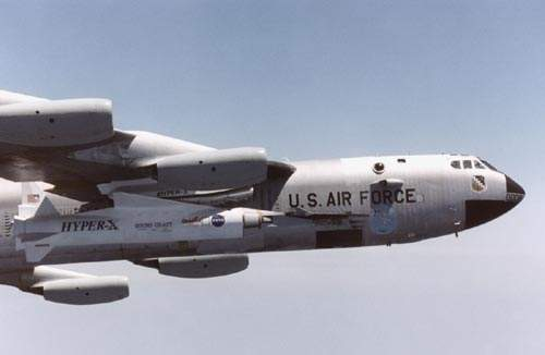 The first captive flight of the X-43A vehicle and the Pegasus booster mounted on the B-52B carrier aircraft over the Pacific in April 2001.