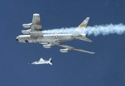 The photograph, taken in June 2001, shows the X-43A and the booster moments after release from the B-52B carrier aircraft, just before ignition of the Pegasus rocket motor.