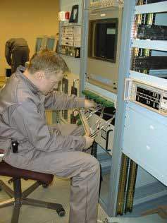 A technician installing part of the data processing equipment.