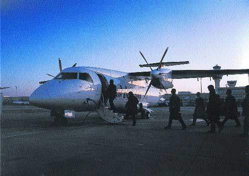 The Fairchild 328 with passengers boarding.