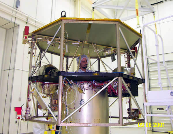 A technician working on the Contour spacecraft.