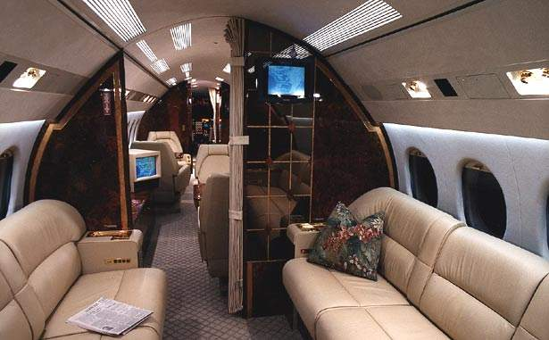 The interior of the Dassault Falcon 900C cabin, built for relaxed travel.