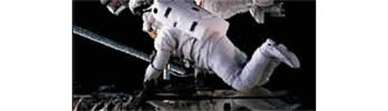 An astronaut during the satellite's three servicing visits.