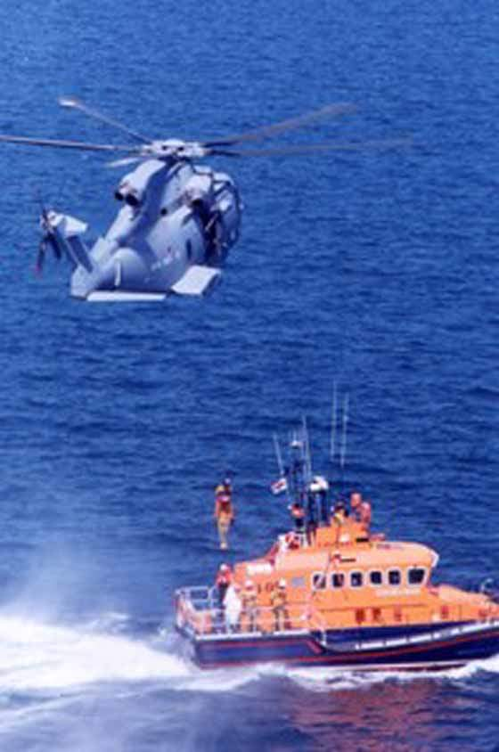 A Royal Navy AW101 winching aboard a 'victim' from a RNLI lifeboat.