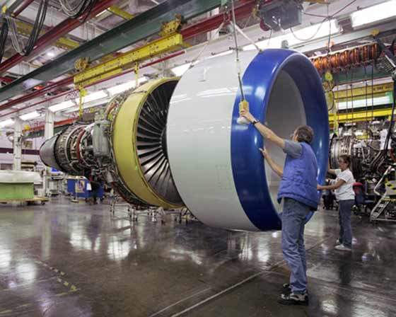 A 767-400 engine nacelle being fitted to A General Electric CF6-80C2B jet engine.