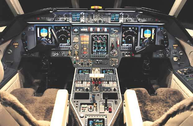 The flight deck of the triengine Dassault Falcon 900C business jet.