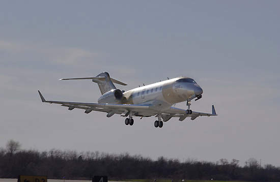 The third Bombardier Challenger 300 business jet successfully completed its first flight on 6 December 2001, shown here taking off from Wichita's Mid-Continent airport.