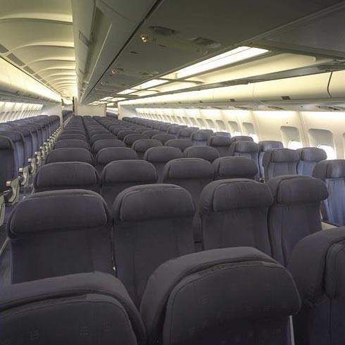 The passenger cabin of a Sabena Airlines A340-300.